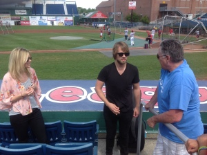 Contemporary Christian musician Josh Wilson (pictured center) performed live at Hadlock Field before the game.